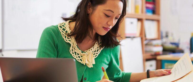 Female Asian Teacher at Desk_banner